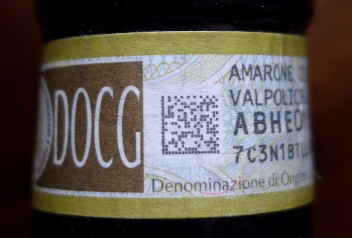 DOCG tag on the neck on an Amarone bottle.