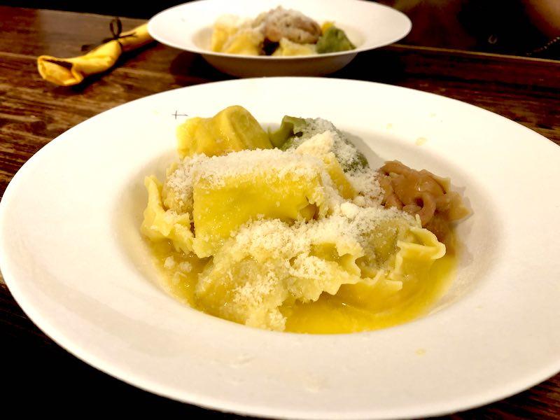 a dish of tortellini and ravioli